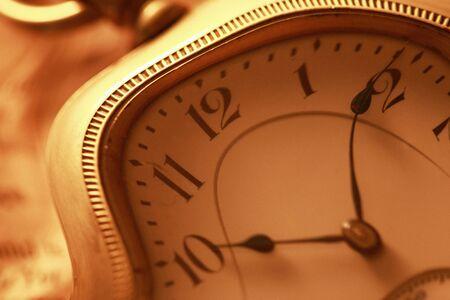 pocket watch: Pocket Watch and newspaper Stock Photo