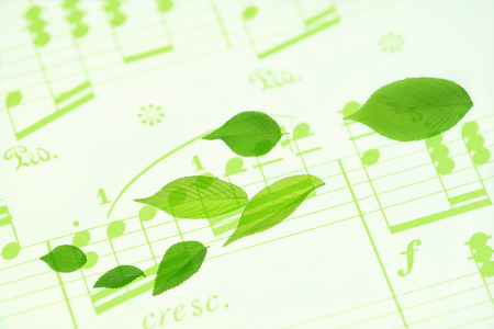 melodies: Sheet music and fresh green Stock Photo