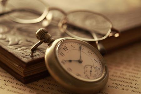retro: Pocket watches and books Stock Photo