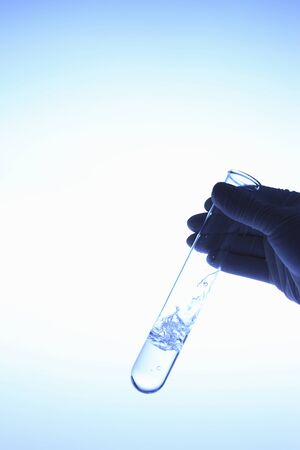 Test tube with hand