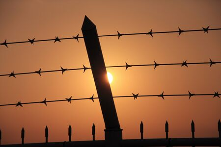 barbed wire fences: Fence Stock Photo