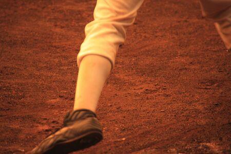 足の野球少年