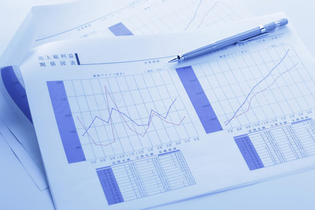 writing utensil: Graph of sales Stock Photo