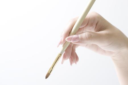 esthetic: Woman with a makeup brush