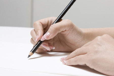 writing utensil: Woman with pencil Stock Photo