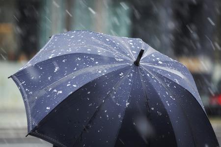 snow falling: Snow Falling on umbrella