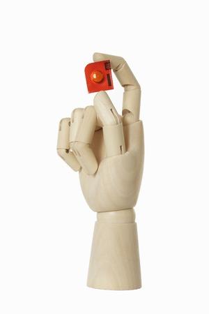 grasp: Wooden hand with medicine