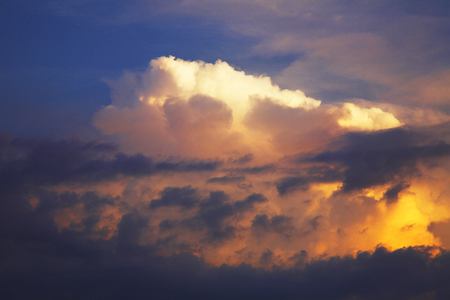 cumulonimbus: Cumulonimbus cloud that is dyed to evening sun