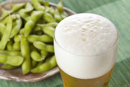 beers: Beers and Edamame Stock Photo