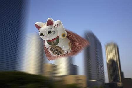 beckoning: Flying beckoning cat Stock Photo