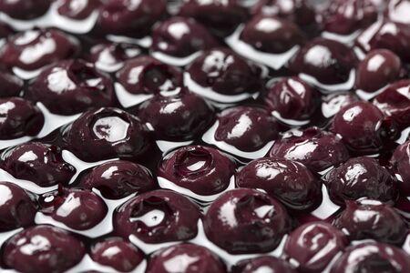 in syrup: jarabe de ar�ndanos