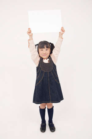 one people: Girl with white board Stock Photo