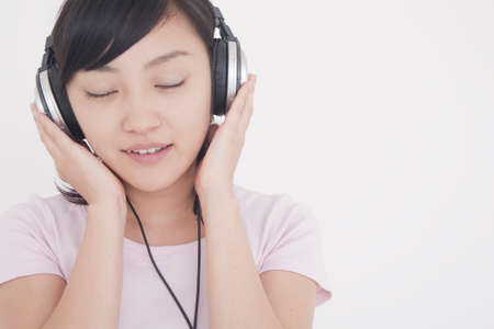 rythm: Woman listening to music
