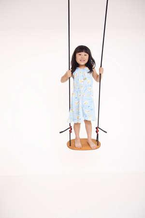 one people: Children rode on swings
