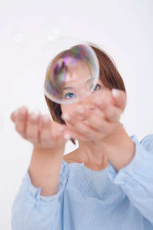 to be pleasant: Women play with soap bubbles