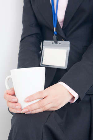 intermission: Hand of woman with mug