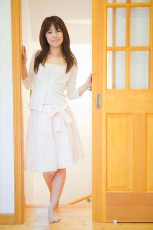 welcome door: Woman to open the door Stock Photo