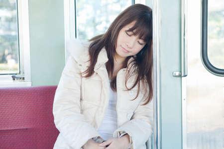 drowse: Women who doze by train Stock Photo