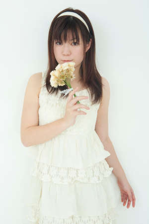 one piece dress: Woman with a flower Stock Photo