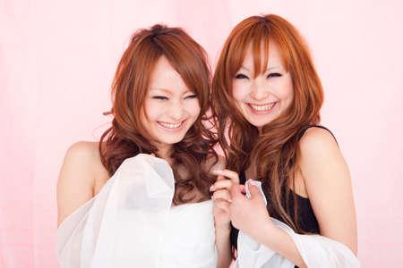 dress up: Women smile twins Stock Photo