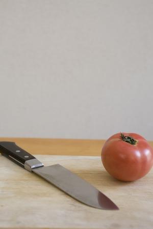 kitchen knife: Tomatoes and kitchen knife Stock Photo