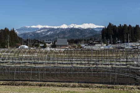 lingering: Norikura from the countryside from Hida Takayama suburbs Stock Photo