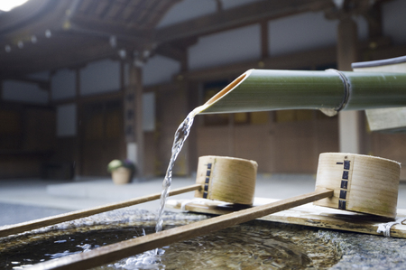 worshipping: Ise Shrine, Chozu in Geku and ladle Stock Photo