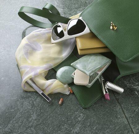 handbag: Contents spilling from handbags