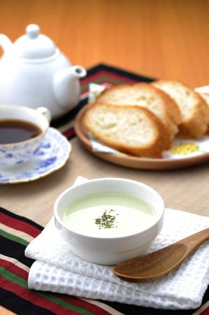 potage: Potage and baguette Stock Photo