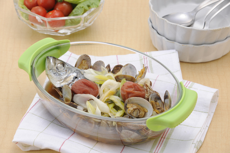 bakeware: Clams and fish dishes in the bakeware Stock Photo