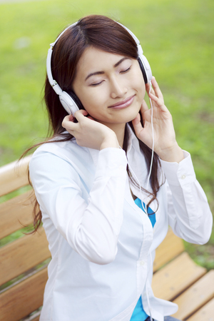 attentively: Women listen attentively to music