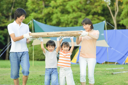 momma: Carry the wood for the campfire family Stock Photo