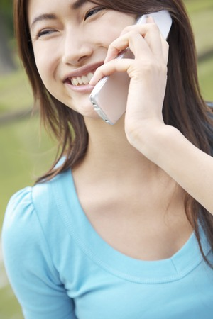 exhilaration: Woman talking on cell phone Stock Photo