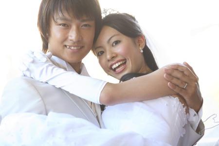 Groom to the princess hug the bride 写真素材