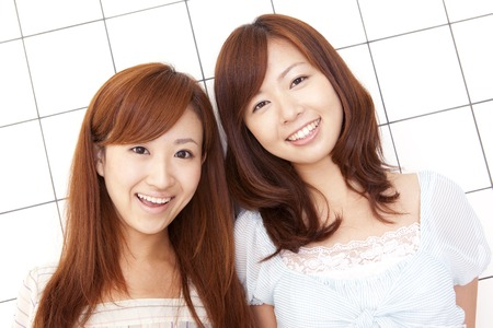 stylish hair: Two smiling women