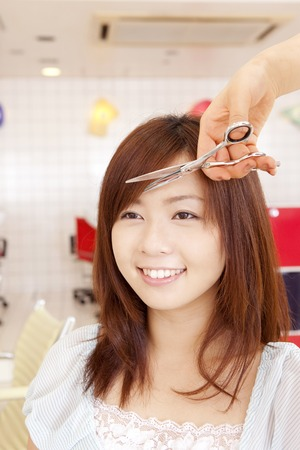 stylish hair: Woman to be cut in a hair salon