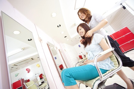Women before cut in a hair salon