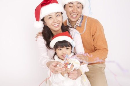 Families enjoy the Christmas party Stock Photo