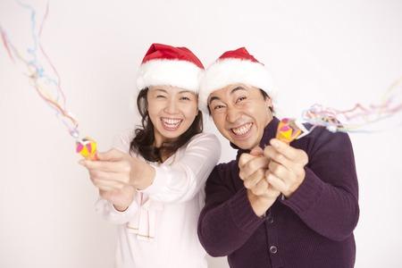 Couple enjoying a Christmas party Stock Photo