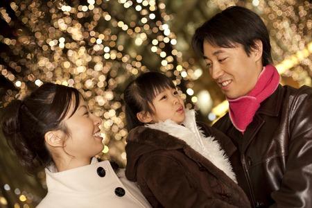 nuclear family: Families enjoy the illumination Stock Photo
