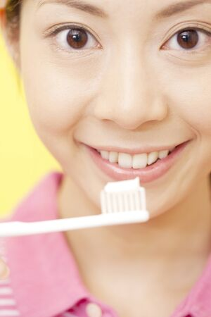gratification: Woman with toothbrush