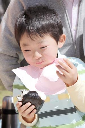 oneself: Boy to stuff oneself rice balls