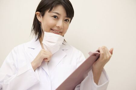 Woman dentist with a binder