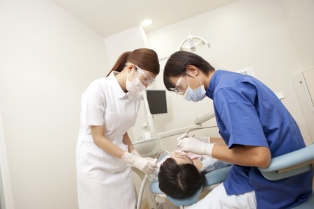 Male dentist and dental hygienist for the treatment of female patients