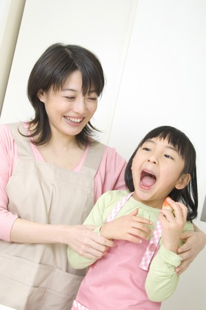 nuclear family: Cooking mother and child