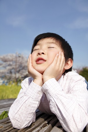 close your eyes: Boy close your eyes with the Hozue Stock Photo