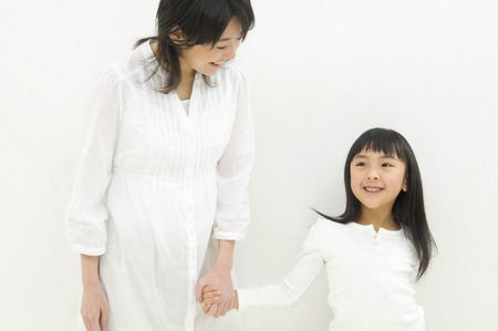 family life: Mother and daughter holding hands Stock Photo