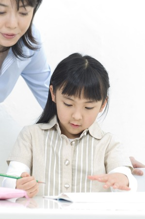 classwork: Learn Learning mother daughter Stock Photo