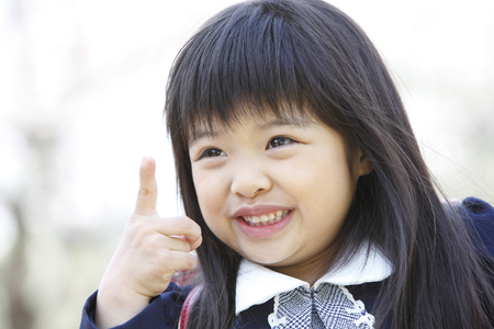 refers: It refers to a cherry finger elementary school girls Stock Photo