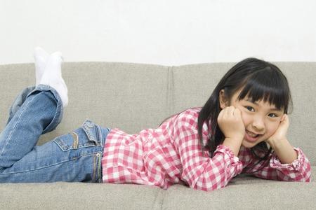Girl lie down on the sofa